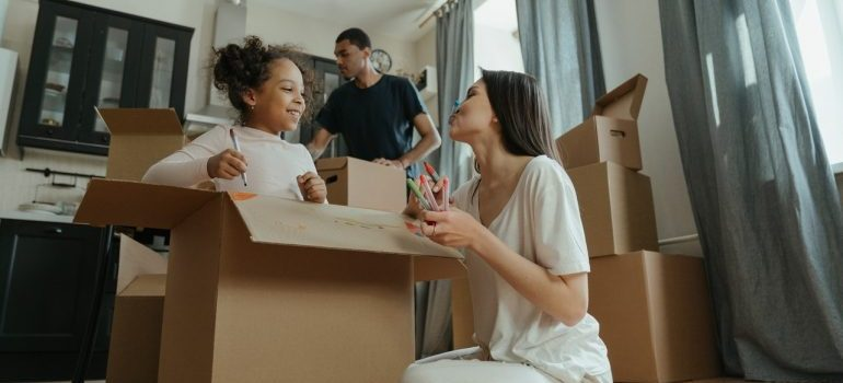 Happy family preparing for joyful relocation with Los Angeles long distance movers.