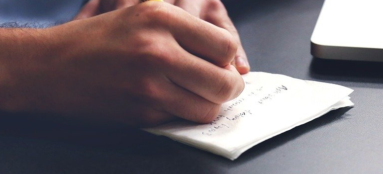 a person writing down a moving plan