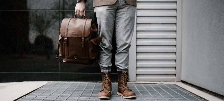 man holding a traveling bag