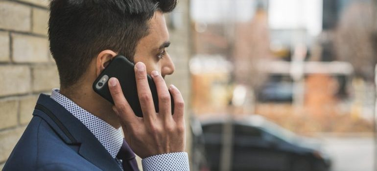 A man in a suit making a phone call.