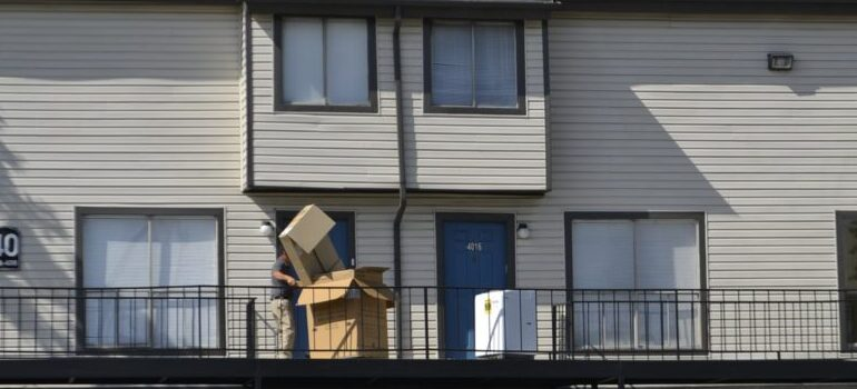 moving boxes in front of the apartment