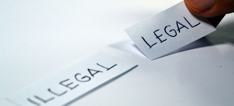 taking a piece of paper that says legal on it