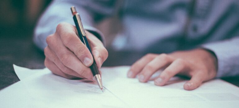 person signing in a contract