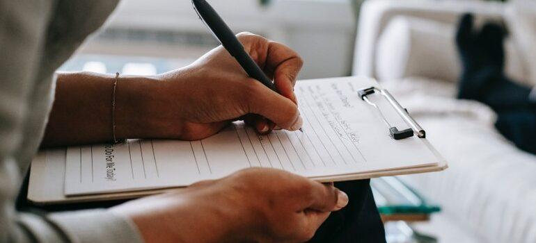 person sitting, writing, making a plan
