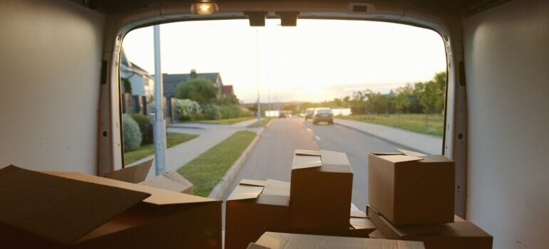 An open van with cardboard boxes, packed by the best cross country movers Jersey City has.