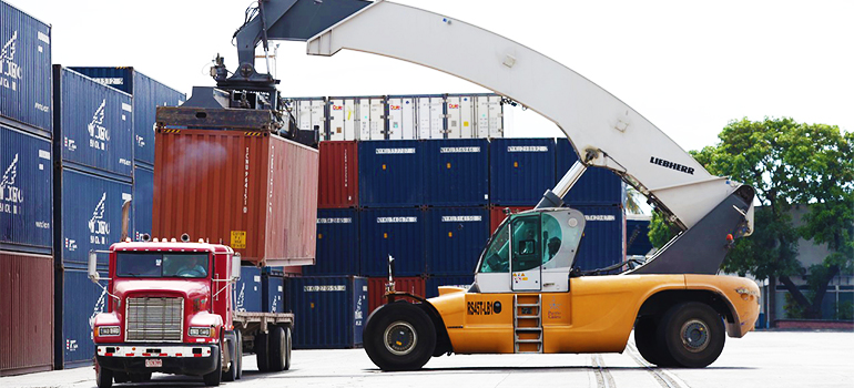 crane loading a truck