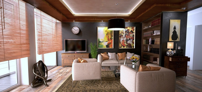 A view of an extravagant living room with a lot of items and furniture.
