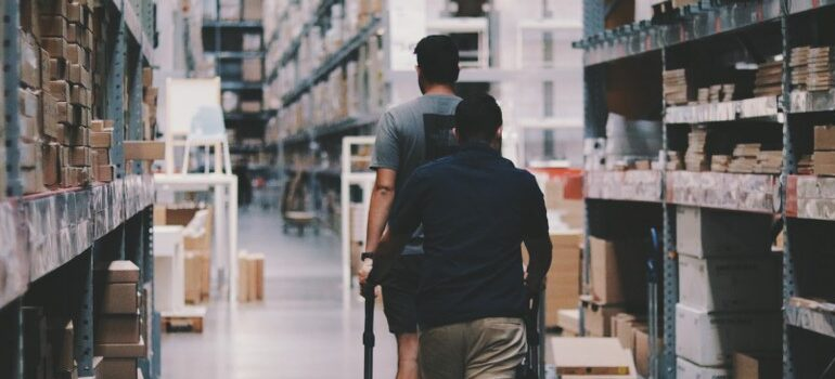 two people going through storage, warehouse
