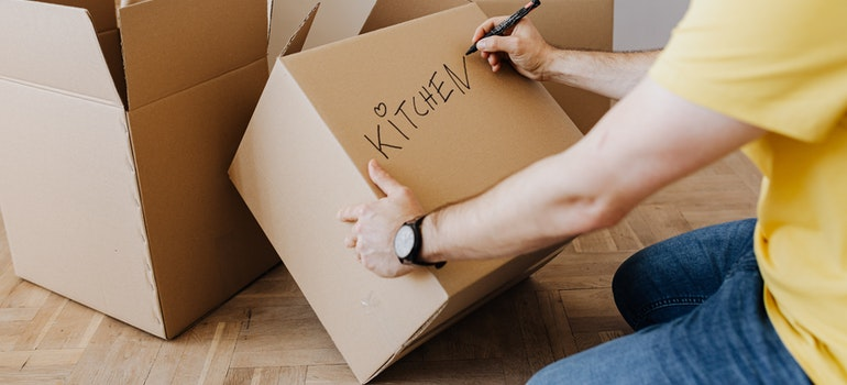 A man labeling a box