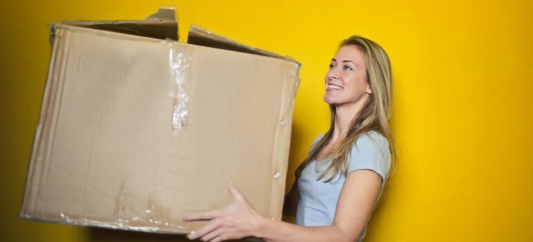 woman holding a moving box