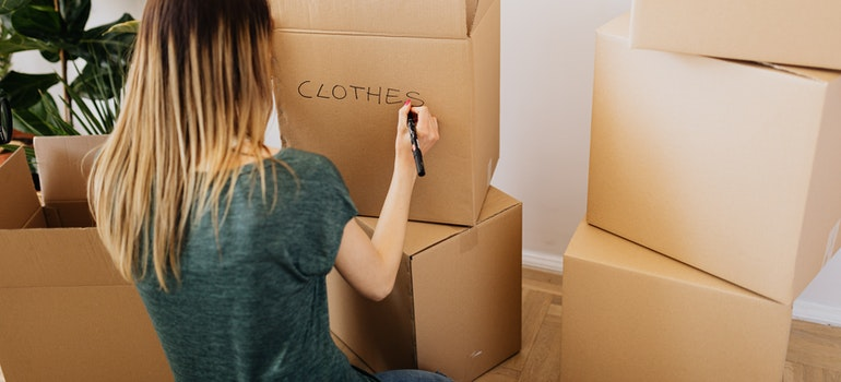 Woman labeling boxes