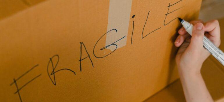 "labeled cardboard box ""fragile"""