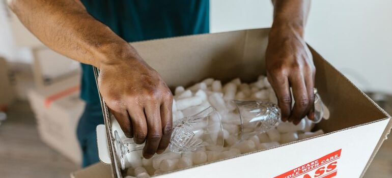 professional mover packing glassware