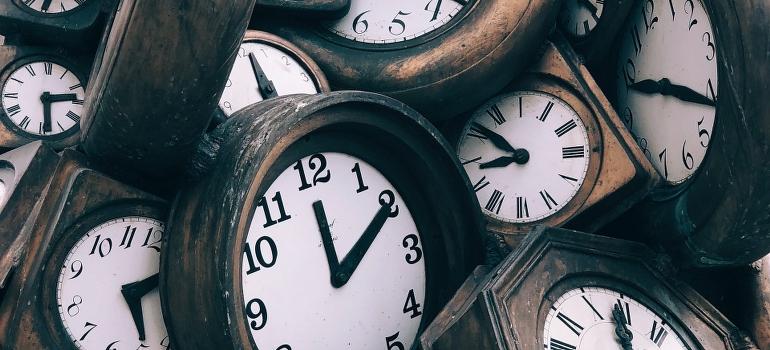 a pile of clocks