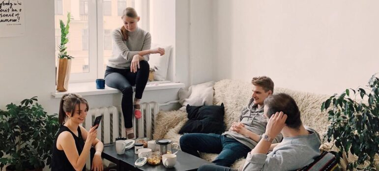 people sitting in a living room