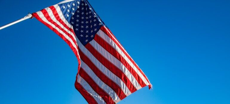 Flag of the United States of America under the blue sky.