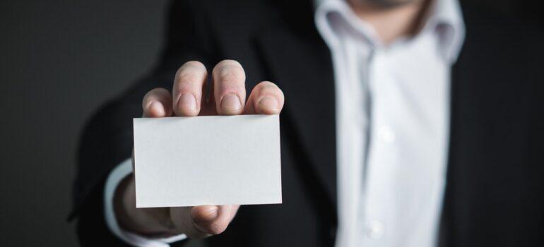 A hand holding a card
