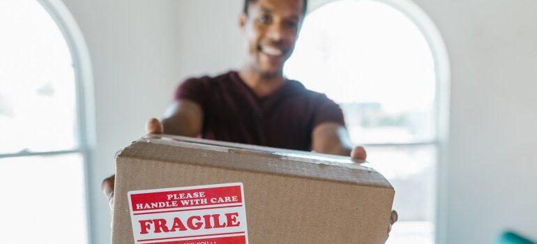 best cross country movers Joliet handling a cardboard box
