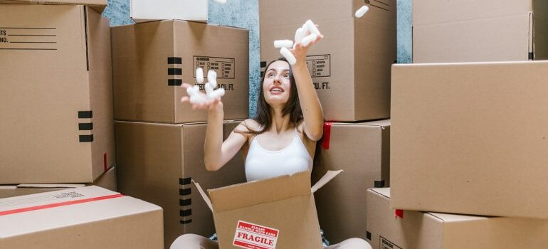 woman playing with packing peanuts