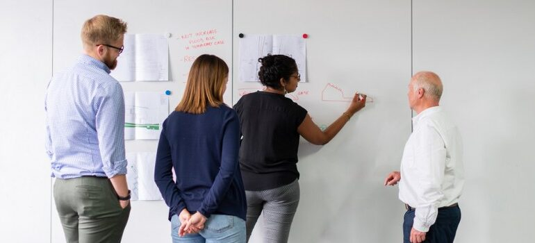 team drawing on a whiteboard