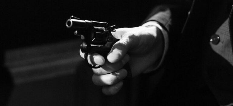 person pointing a gun