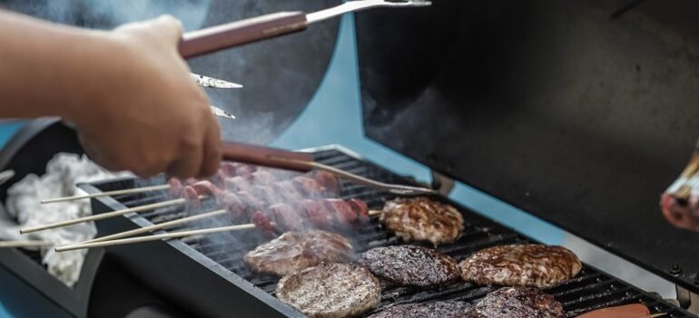 person preparing a barbecue