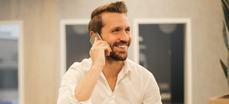 a person talking on a phone, smiling