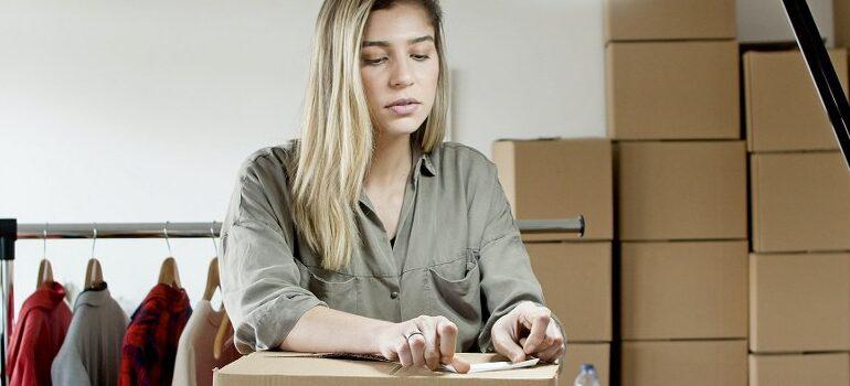 woman packing a cardboard box