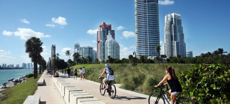 People riding bicycles on the track in Miami Beach.