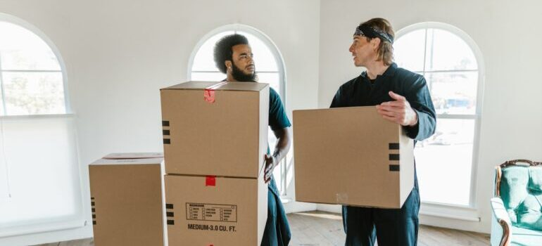 Workers pack things for moving
