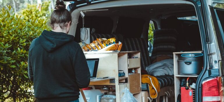 person filling a moving van with stuff