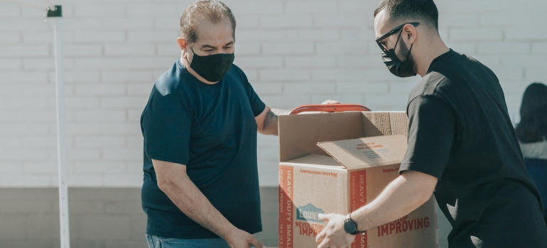 movers handling a box