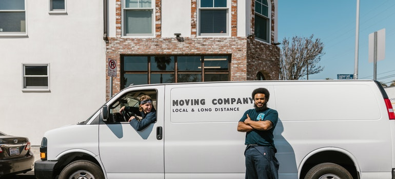 two guys and a white moving van