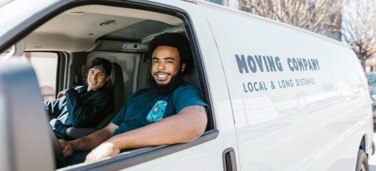 Two movers in a moving truck.
