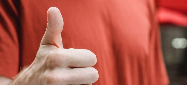 a person holding thumbs up