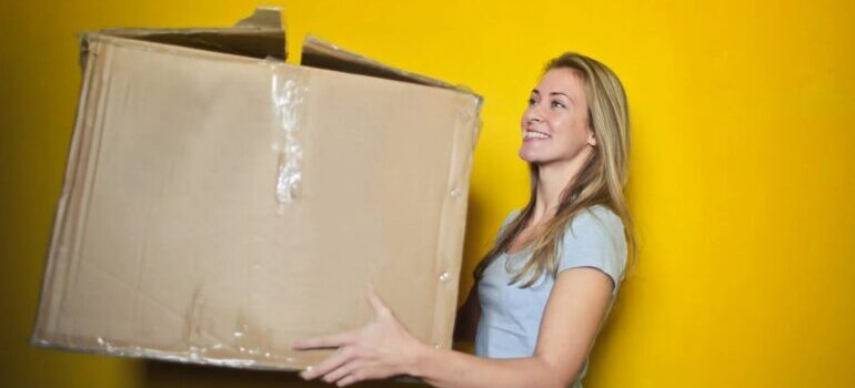 woman moving with the help of the best cross country movers Winston-Salem