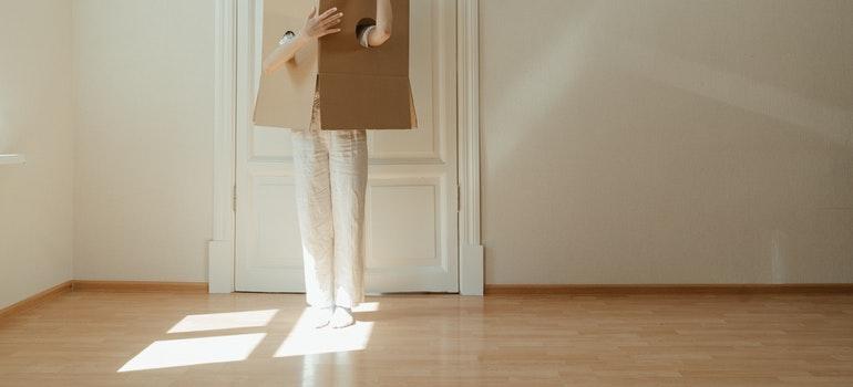 a person in a cardboard box