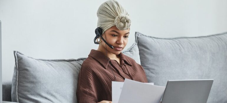 woman using a headset to communicate over the internet