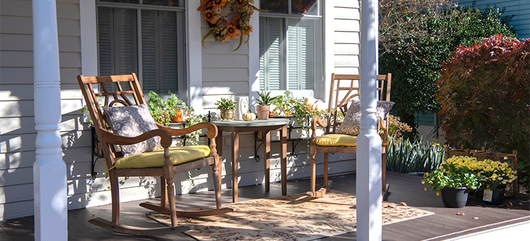 a rocking chair on the porch