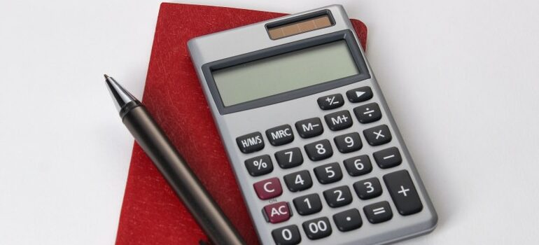 calculator, a pen, and a notebook - a couple of things you will need to compare interstate moving companies in Arkansas